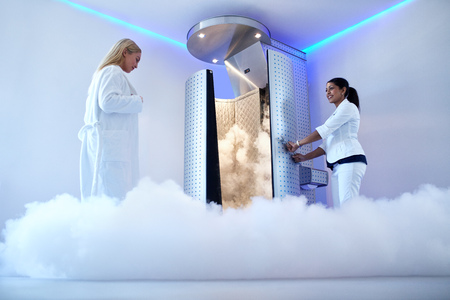 Portrait of woman going for cryotherapy treatment in cryosauna booth.