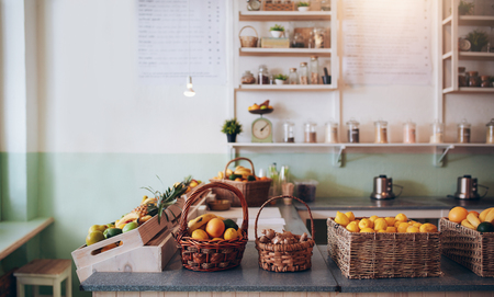 Fruit juice bar counter with fruits in basket. Stock Photo - 56274319