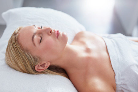 woman sleep: Close up of attractive woman at dayspa. She is lying on massage table. Beauty and health concept.