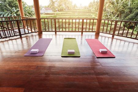 meditation room: Empty yoga studio with colorful mat and yoga brick.
