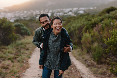Portrait of happy young couple having fun on their hiking trip. Hiker couple enjoying themselves on vacation.