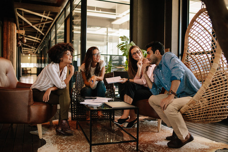Team of corporate professionals having discussion in meeting. Multi ethnic business team having project discussion. Stock Photo