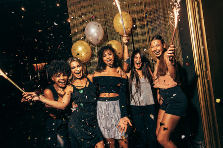 Shot of group of girls in the nightclub having a great time. Group of female friends partying in pub. photo