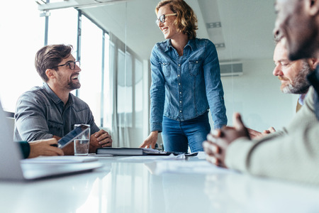 Young business woman leading a boardroom meeting with her collegaues. Female leadership. Stock Photo