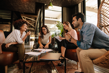 Group of businesspeople having a meeting in a modern office. Business team having conversation over new project. Stock Photo