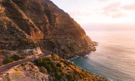 Roadtrip in beautiful landscape. Car driving on the famous Chapmans Peak Drive stretch close to Cape Town, South Africa. Banco de Imagens