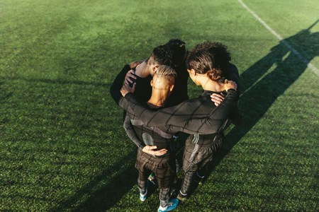 Five a side football team gathering before match. Young soccer team standing in a huddle. Stock fotó