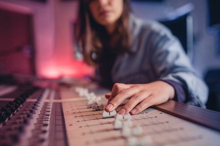 Woman hands mixing audio in recording studio. Female hands working on music mixer. Music production technology. Stock Photo - 87746131