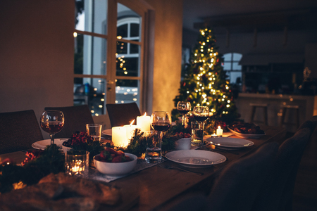 Specially decorated christmas table at home for dinner. Beautifully set dining table for Christmas Eve.