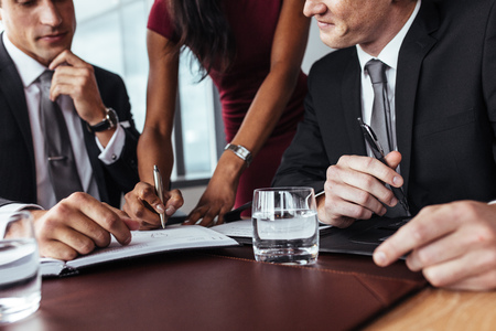 Businesswoman hands signing a document. Businesspeople sign up contract during a meeting in office. Archivio Fotografico