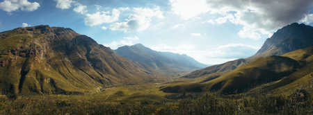 Panoramic view of scenic mountains and valley in Jonkershoek nature reserve. Mountain landscape with cloudy sky.
