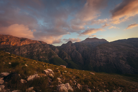 Majestic mountain sunset with colored sky and clouds. Dramatic sky over Jonkershoek nature reserve.