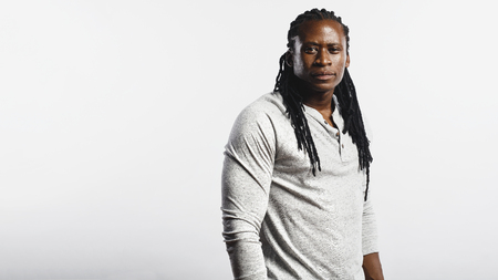 African male with dreadlocks isolated on white background. Man looking at camera. 写真素材