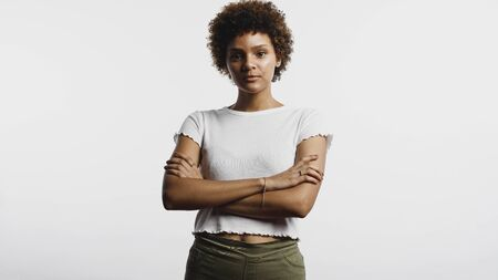 Portrait of young woman isolated on white background. Woman with curly hair looking at camera.