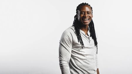 Muscular african male with dreadlocks isolated on white background. Smiling african man looking at camera. 스톡 콘텐츠