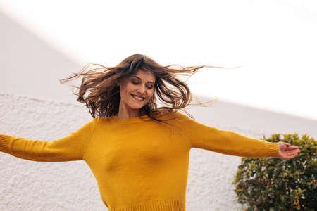 Pretty woman dancing outdoors. Happy young woman dancing and enjoying outdoors.