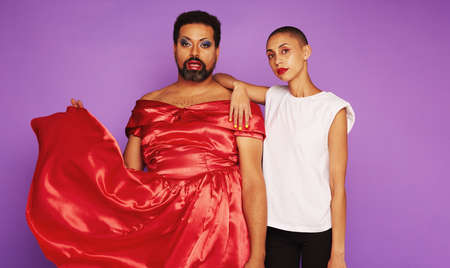 Man in female clothing and woman in male clothing. Models breaking the gender stereotypes