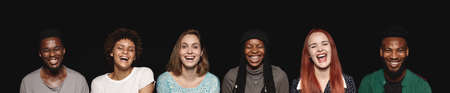 Panoramic shot of multiethnic people laughing. Cropped wide angle shot of young men and women on black background.