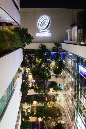 Bangkok Thailand - March 7 2018: Aerial shot of The Emporium and Emquartier Department Store in Bangkok Thailand at night time. Editorial