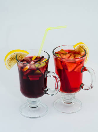 Mulled wine in glass with lemon