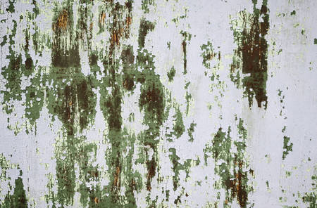 The texture of the old damaged walls with paint