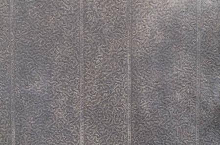 bumpy: Black metal plate with bumpy surface closeup.
