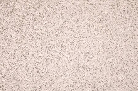 grit: Light texture of the wall with fine grit, rough