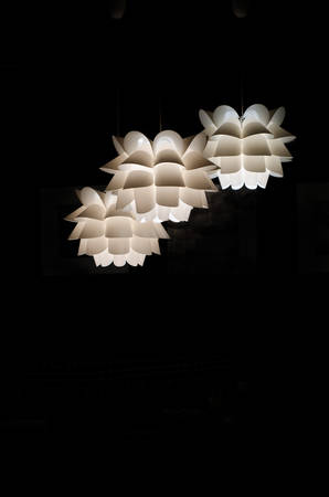 plafond: Designer ceiling lamp three pieces on a black background. White plafond
