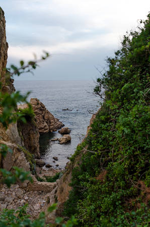 Cliffs of Cala de Sant Francesc, the coastline of the Bay of Blanes, Costa Brava, Spain. Picturesque view from above.