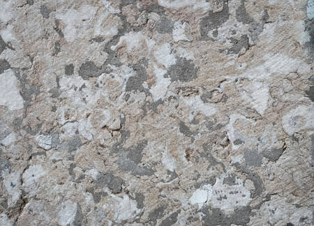 Texture of marble is multicolored with a large pattern-cracks, spots.