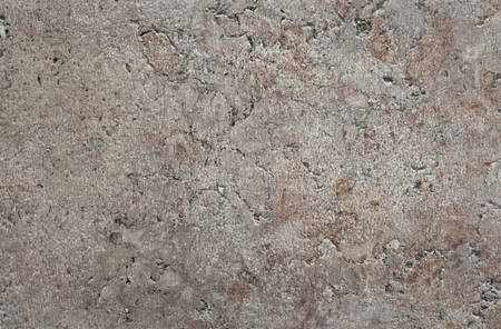 Texture of the stone is brown-gray with cracks, spots.