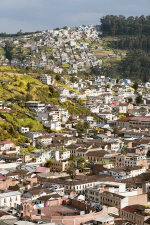 Quito neighborhood , south part of the city. Traditional houses over the city hills. photo