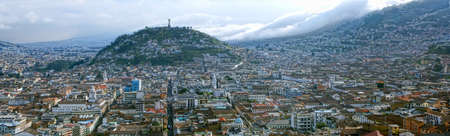 quito: Panorama of south part of the city. In background Virgin of Quito statue on Panecillo Hill overlooking the city Stock Photo