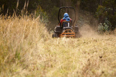 Riding lawn mower blowing grass Stock Photo - 9111488