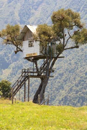 tungurahua: Tree house near Banos , Ecuador. Best place to watch Tungurahua volcano in this area. Stock Photo