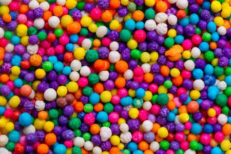 Closeup shot of a very small colorful candies used for cakes decorations. Stock Photo - 9253917