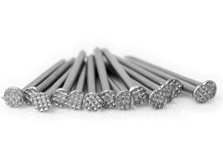 disordered: Disordered pile of wood nails isolated on white, studio shoot. Stock Photo