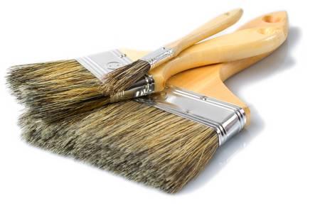 set of three wooden brushes isolated on white background, studio shot photo