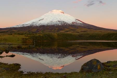Cotopaxi volcano refelcting in Santo Domingo laguna Stock Photo
