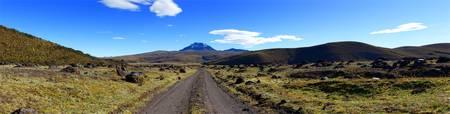 ecuador: Road leading to Sincholagua  volcano,many volcanic eruption marks