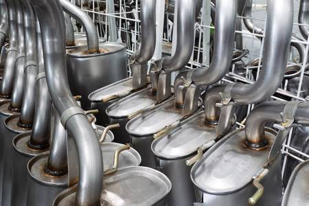 Exhaust pipes stand before galvanization painting process. Stock Photo