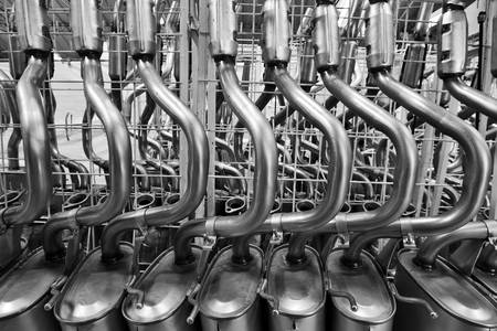assembly: Exhaust pipes stand before galvanization painting process. Stock Photo