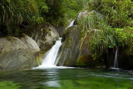 ecuadorian: Smal waterfall in Ecuadorian cloudforest, shot from the water level