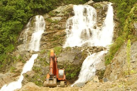 dozer: Beautiful waterfall threatened by a dozer in Ecuadorian Andes mountains