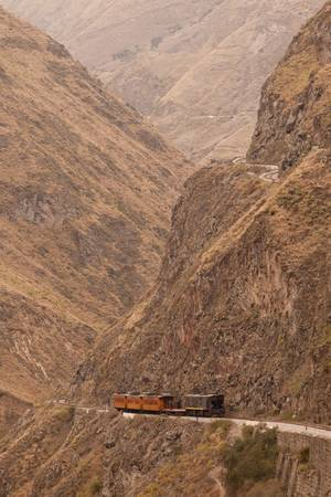 ecuador: Train going up on Nariz del Diablo, very important tourist attraction in Ecuadorian Andes.Observe the difference between lower and upper route. Stock Photo