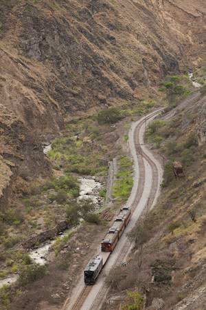 guayaquil: Touristic train passing by Alausi city in Ecuadorian Andes