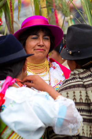 veneration: PUJILI,ECUADOR - 25 JUNE 2011: womens dressed up in traditional costumes for Inti Raymi festival that is celebrated on 25 JUNE 2011  Editorial