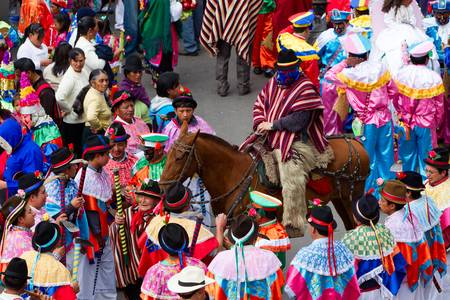 veneration: PUJILI,ECUADOR - 25 JUNE 2011: group of men dressed in traditional colorful costumes on the streets of Pujili , Inti Raymi festival celebrated on 25 JUNE 2011