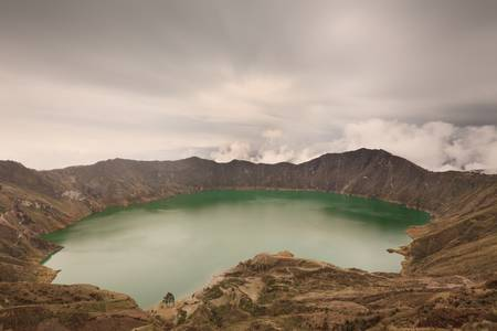 crater lake: Quilotoa lagoon in Ecuador`s highlands of Andes formed on an ancient volcano crater.
