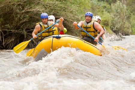 Group of powerful young men on a rafting boat  Patate river , Ecuador photo